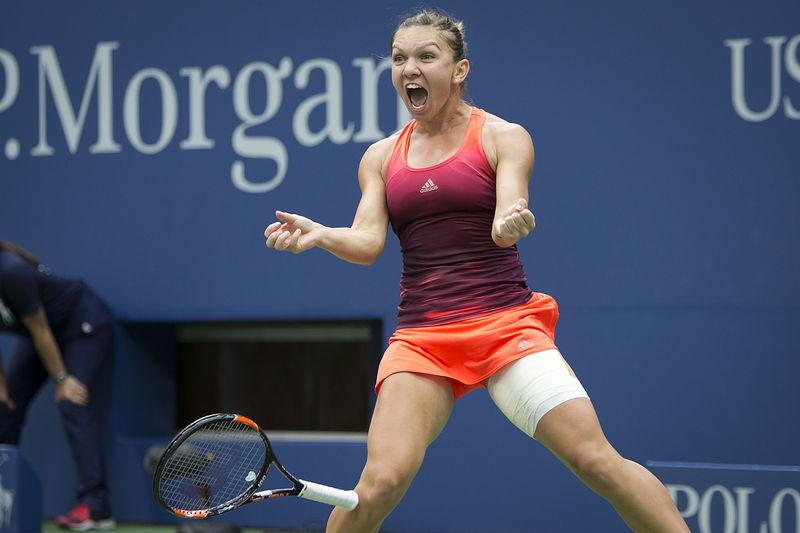 Simona Halep of Romania celebrates after defeating Victoria Azarenka of Belarus in their quarterfinals match at the U.S. Open Championships tennis tournament in New York, September 9, 2015. REUTERS/Carlo Allegri