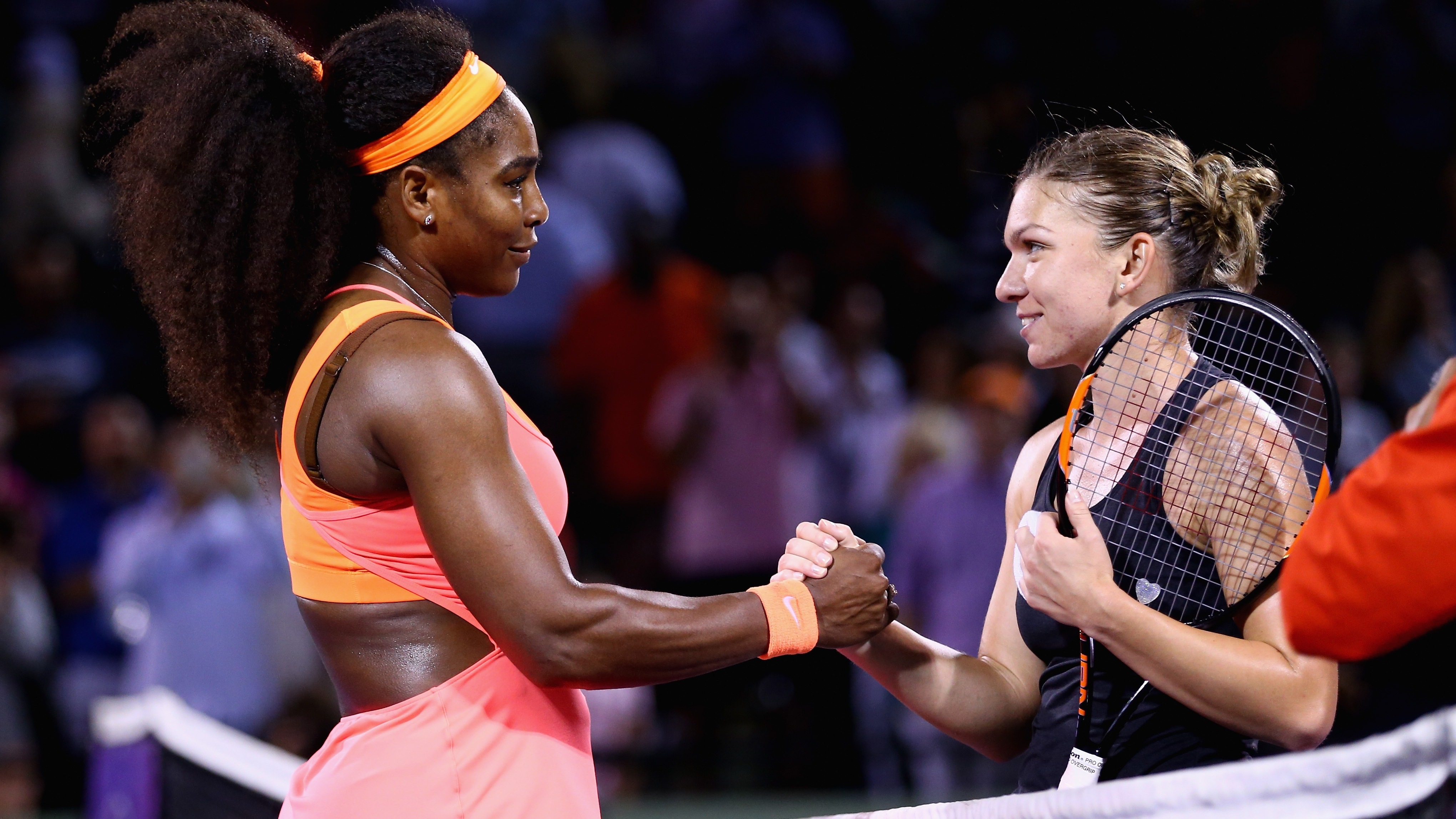 KEY BISCAYNE, FL - APRIL 02: Serena Williams of the United States shakes hands at the net after her three set victory against Simona Halep of Romania in their semi final match during the Miami Open Presented by Itau at Crandon Park Tennis Center on April 2, 2015 in Key Biscayne, Florida. (Photo by Clive Brunskill/Getty Images)