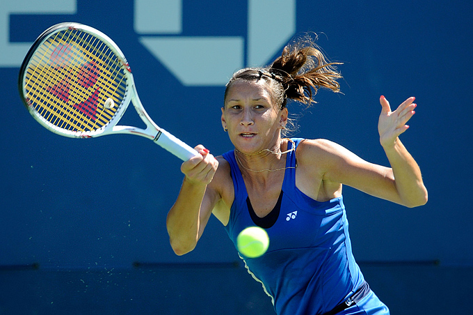 NEW YORK, NY - AUGUST 30: Ekaterina Bychkova of Russia returns a shot against Andrea Petkovic of Germany during Day Two of the 2011 US Open at the USTA Billie Jean King National Tennis Center on August 30, 2011 in the Flushing neighborhood of the Queens borough of New York City. (Photo by Patrick McDermott/Getty Images)