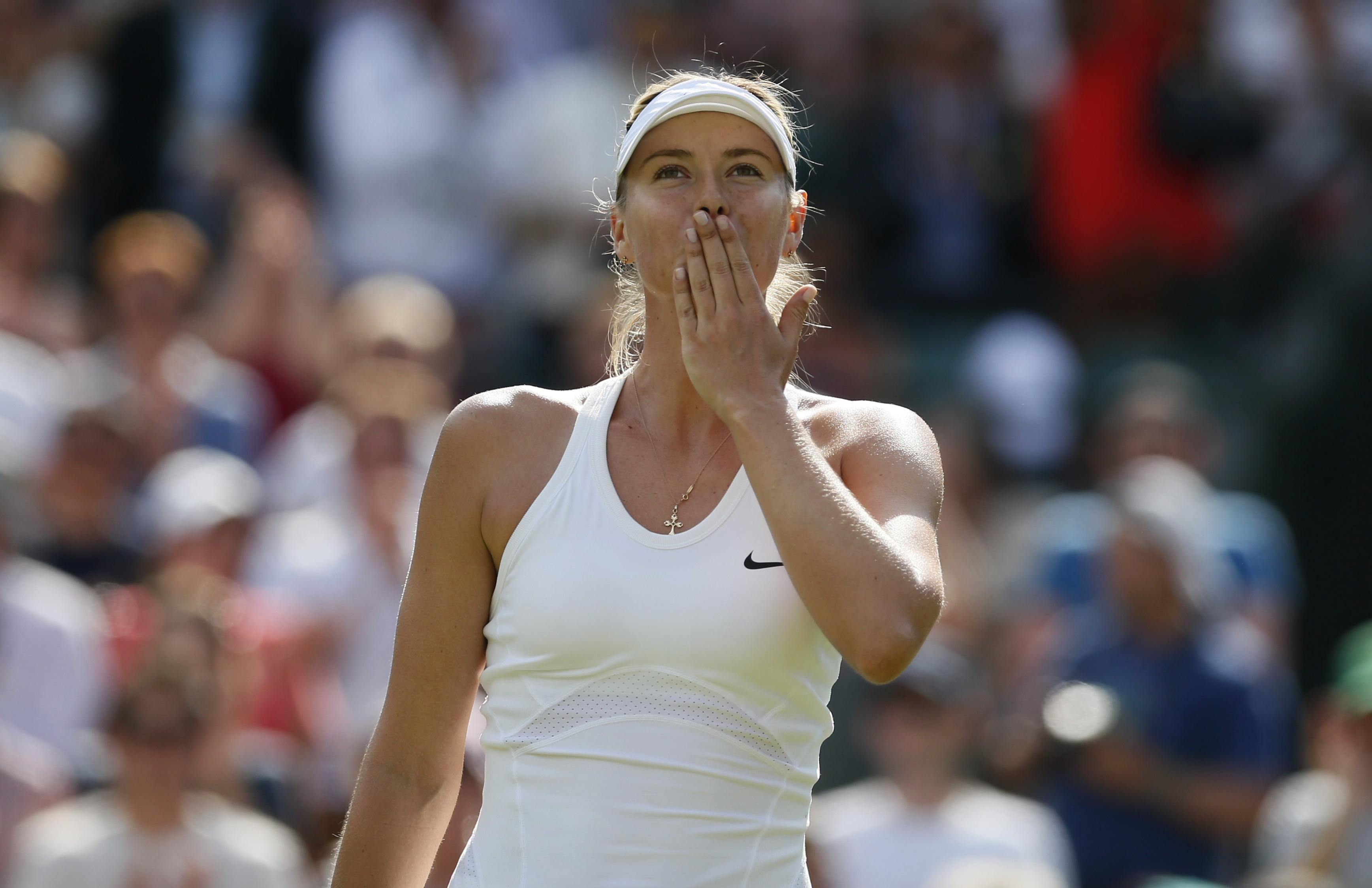 Maria Sharapova of Russia blows a kiss after defeating Samantha Murray of Britain in their women's singles tennis match at the Wimbledon Tennis Championships, in London June 24, 2014. REUTERS/Stefan Wermuth (BRITAIN - Tags: SPORT TENNIS) - RTR3VHMS