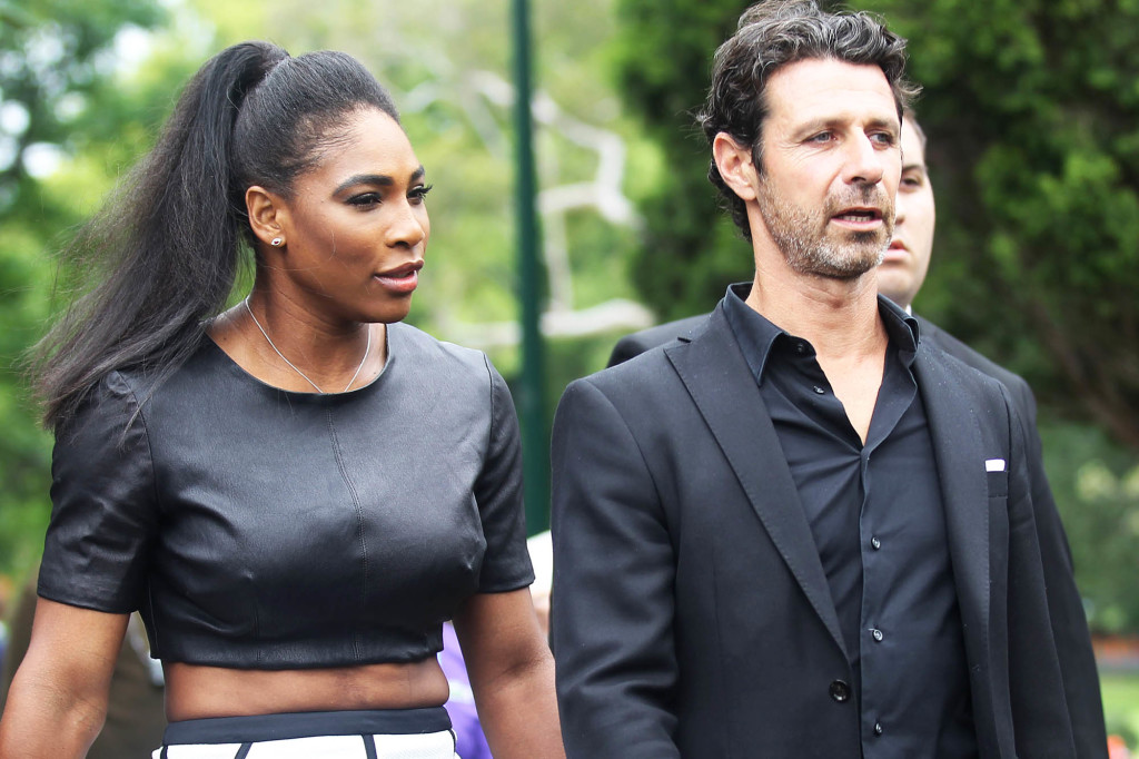 Serena Williams poses with the Women's Singles Trophy after winning the Women's singles final at the 2015 Australian Open last night. Serena wore a black leather top with a white skirt as she posed with the trophy at Carlton Gardens. Serena was also seen walking with coach and boyfriend Patrick Mouratoglou. Pictured: Serena Williams