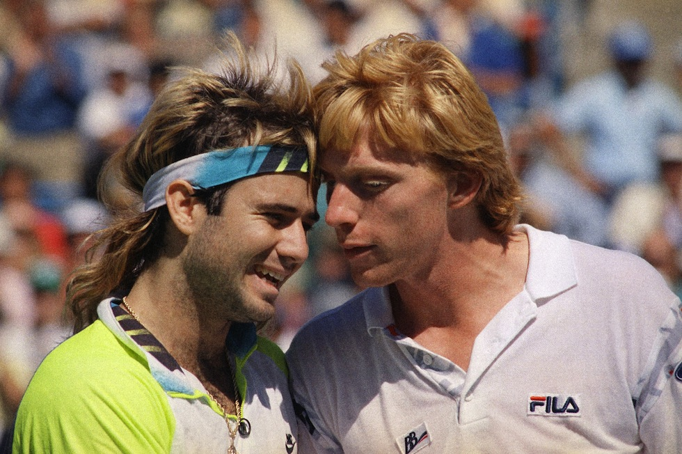 Fourth-seed Andre Agassi, left, and top-seeded Boris Becker speak at the net after Agassi eliminated Becker in the semifinals of the U.S. Open Tennis Tournament in New York, Saturday, Sept. 8, 1990. Agassi won 6-7, 6-3, 6-2, 6-3. (AP Photo/Peter Morgan)
